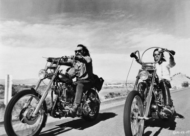 "Original Caption: Dennis Hopper (with mustache) and Peter Fonda in scene from the movie: ""Easy Rider.""  June 30, 1969."